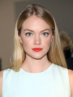 Lindsay Ellingson glows with a fresh complexion and a bright red lip