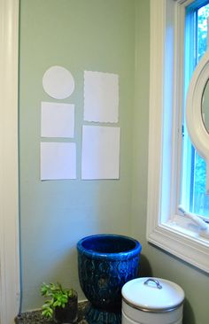 How to hang picture frames easily--cut out paper template, mark where the hanger is with a pencil, tape up frame templates, put nail where hole is and then rip off paper. Via Young House Love.