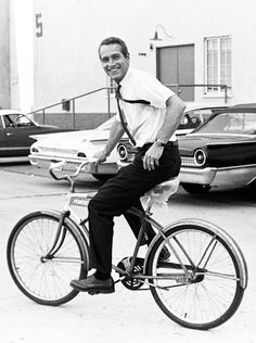 Paul Newman on the Warner Bros. lot during the filming of Harper (1966). Note the cars in the background.