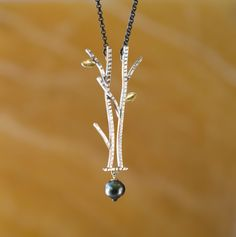 Tree of Life Series  |  Tree & Tahitian Pearl  |  Sterling silver with 18K gold leaves and a black Tahitian pearl drop.