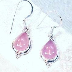 Pink Opal Earrings In Sterling Silver, Handmade Jewelry. Classic teardrop setting, can be personalized/engraved on back. About opals. Known as the queen of gemstones, opal is an October birthstone and a 14th anniversary gemstone. Opal is said to bring out love, loyalty, peace,