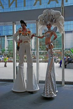 Stilt walkers at the entrance to The Shoppes at Marina Bay Sands Check out this... YTE have all kinds of entertainers too. Find us at http://www.YourTotalEntertainment.com