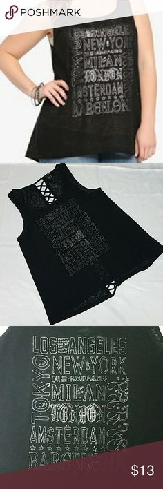 Torrid Graphic Tank Top Torrid Graphic tank top with cut out back. Size 2 torrid Tops Tank Tops