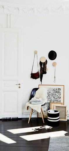 minimalist white wall entryway