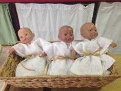 """All dressed up and ready to be baptized . . . again and again. Children in a Godly Play room get to work with the stories, and a perpetual favorite is the lesson on Baptism. Here are the """"babies"""" we use in my room (acknowledging that baptism can happen at any time in a person's life). Children love finding a baby with a skin tone near their own. And this story *never* stays on the shelf during work time!"""