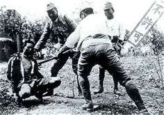 Prisoner of War being bayoneted by Japanese Soldiers during Bataan Death March.