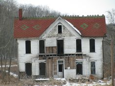 Old abandoned house, I love the architecture and the roof with the design on it.