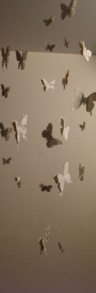 just in case I ever have a daughter, love that these are not just hanging butterflies but hanging butterflies made out of book pages