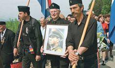Modern Ustasha Nazis, parading through present day Croatia. Carrying WW2 Croatian führer pictures, as well as ww2 nazi flags and insignia. Present day Croatia.