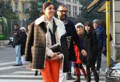 tommy tom shoots street style at couture shows... yummy shearling plaid combo