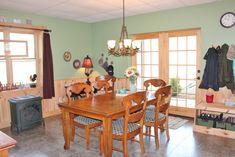 Dining area is nice and bright and gives access to the outdoor patio if you prefer to eat outdoors. Includes cast iron stove with gas logs. Timber Frame Home Plans, Timber Frame Homes, Log Cabins For Sale, Cabin Style Homes, West Jefferson, Cast Iron Stove, Thing 1, Dining Area, House Plans