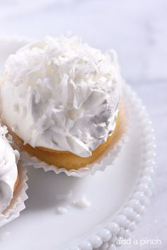 Marshmallow Frosting Recipe -This billowy and light frosting is such a favorite atop cupcakes, cake and cookies! Amazing lightly toasted with a kitchen torch for extra fun! from addapinch.com