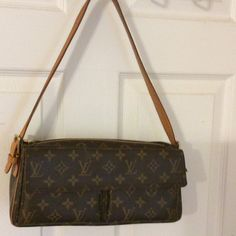 DAUGHTER WANTED Excellent condition. Vive cite PM Monogram. Guaranteed authentic, bought at Bloomingdale's in NYC. This is a rare and hard to find bag. Will miss terribly! Leather is starting to patina. Will include original dust bag. Price is negotiable!!  NO TRADES and plz don't insult by LOW BALLING. Let's keep the negotiations within the ballpark of the quality of this fine piece. It is in A1 condition. Louis Vuitton Bags