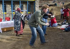Pin for Later: 27 Pictures of the Royal Family Dancing Their Bums Off Harry With Schoolchildren in Lesotho in June 2010