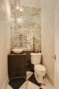 mirrored subway tile helps a small bathroom feel larger