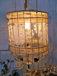 Rusty vintage birdcage light (upside down) and doilies