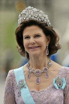 At Victoria's wedding, Silvia paired the tiara with the family's pink topaz demi-parure, which was made in 1804 for Maria Pavlovna and came into the family with Queen Victoria