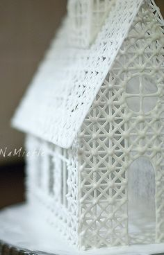 Intricate Icing house!  This would be cool made with chair caning....sprayed white.