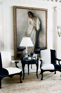 Chic and tasteful: A townhouse sitting room from Ralph Lauren Home. Two-toned Clivedon Carved Chairs flank the Mayfair Side Table topped with the Crystal Prism table lamp.