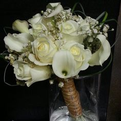 Gold and White Prom Bouquet with roses and calla lilies