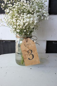 Problem solved...2 in 1 centerpiece AND table number!  Perfect for a tight budget!