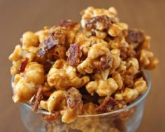 Bacon Caramel Popcorn - Bacon adds a whole new layer of flavor to traditional caramel corn in this recipe for Bacon Caramel Popcorn! Chunks of crispy, salty bacon are mixed with caramel corn and toasted pecans, and then everything is baked together until you have sweet, crunchy clusters. If you want to go really crazy, you can drizzle the whole thing with chocolate when you're finished - Elizabeth LaBau, licensed to About.com, Inc.