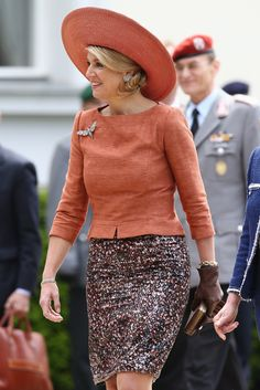 Maxima is a tangerine dream in an orange  peplum top and a beige skirt, and nude court shoes completed the look as she arrives at the Chancellery to meet Angela Merkel in Berlin.
