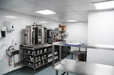 Polarex Hygienic PVC Wall Cladding in Satin White installed in a commercial kitchen. Pvc Wall Panels, Ceiling Panels, Cladding Sheets, Food Safety Standards, Steel Cladding, Ceiling Cladding, Shower Panels, Wet Rooms, Commercial Kitchen
