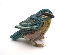 Embroidered bird by BA Textile Design student Catherine Frere-Smith, studying at the Chelsea College of Art and Design. Catherine creates prints of houses and birds that can be transformed into miniature models.