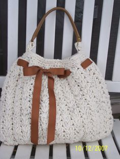 Front of Crocheted Purse  @Erin Davis buy me the color yarn, and embellishments you want :)