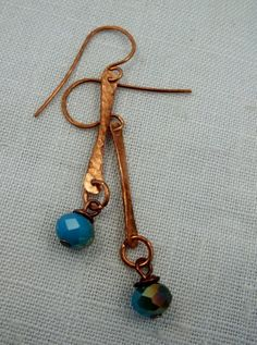 Hammered copper earrings with blue czech beads.  by KABADESIGNS