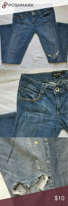 Distressed jeans Distressed jeans. Some yellow-ish paint on jeans but its the design. Studded pocket and tear in the knee. Rewind Jeans Skinny