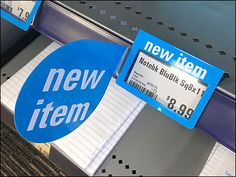 """Though the office paper product, shelf edge label and """"New Item"""" Flag are seemingly color matched, the true fixtures news… Price Tag Design, Kids Toothpaste, Supermarket Design, Office Paper, Retail Merchandising, New Item, Product Label, Retail Design, Close Up"""