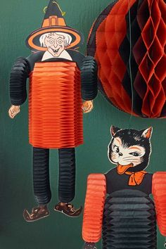 """Beistle's """"Dancers,"""" so called for their bouncy, accordion-like arms, legs, and torsos, were among the company's most popular decorations.This cat dancer,produced from 1948 to 1964, garners around $20. Dancers with a shorter production run, like the very rare 1930 Devil Dancer (not pictured), which was produced for a single year, can bag up to $450."""