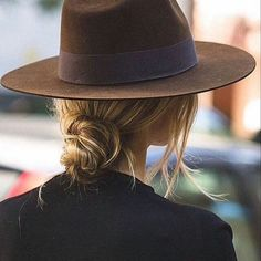 This modern chignon is perfect with the great hat!