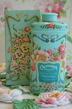 Vintage California talcum powder. I have an empty container of this, but it's not in nearly as good condition as the one in this pic. But it's so pretty anyway! (Unfortunately I do not know the original source of this photo.)