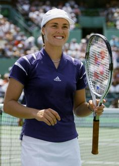 Martina Hingis of Switzerland smiles after defeating Monica Seles of the US in their semifinal match 30 March at the Ericsson Open on Key Biscayne FL...