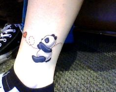 Small Panda With Heart Tattoo On Leg