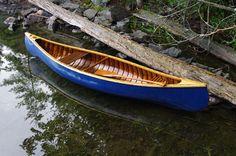 'Blue Canoe' 1920's 12 Foot Chestnut Wood and Canvas Canoe.