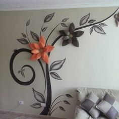 Maybe smaller and simplified, without the big flowers, to curl around a door?