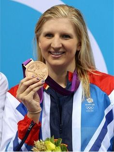 Bronze medallist Rebecca Adlington of Great Britain poses on the podium during the Victory Ceremony following the women's 400m Freestyle final on Day 2 of the London 2012 Olympic Games at the Aquatics Centre.