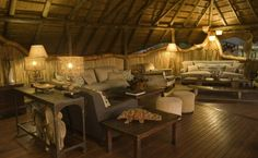 The central part of Chitabe Camp is made up of a thatched dining area and lounge leading onto open decking, all built on raised decks to provide superb views across a floodplain. West Indies Style, British West Indies, Dining Area, Dining Table, Raised Deck, Okavango Delta, Dark Furniture, Lounge, Wooden Decks