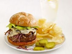 Swiss Mushroom Burgers : Nutty Gruyere cheese is melted on top of sauteed onions and mushrooms for this melty cheeseburger.