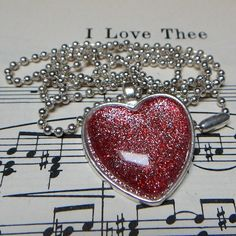 Like, share, repin :D   Enjoy    Red and Silver HEART handmade GLITTER glass necklace from pamreily