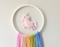This super adorable Unicorn Garland is lovingly handmade by me. Perfect for a nursery wall, along a crib or change table, bedhead or to hang in a window! Includes:  3 x Felt Unicorns approx. 18x14cm  . . . Please Note . . . - This Hanging is made to order. - Please take note of the processing time before ordering. The processing time refers to how long I have to post it/how long it will take to make. - Once dispatched your order can take anywhere from 2-14 business days to reach you, dep...