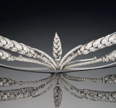 A belle époque diamond tiara, circa 1910 The stylised spray of ears of wheat, millegrain-set throughout with old brilliant and single-cut diamonds, mounted in platinum, diamonds approximately 16.90 carats total, originally detachable from frame to be worn as two corsage ornaments, fittings supplied, Cartier case.