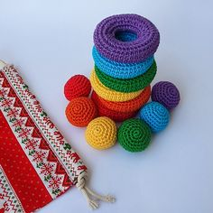 The benefits of the rainbow stacking toy: 1. Develops children's motor skills by playing first with the rings and then with the full set 2. Develops space orientation 3. Supports learning concepts like far-close 4. Supports learning concepts like big - small 5. Helps the child learn the basic rainbow colors 6. Helps the child associate colors 7. Children can use it to learn how to count