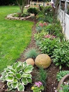 Love the layout of this garden. The garden accents (concrete balls, trellis, picket fence and birdbath) look | http://garden-interior.blogspot.com