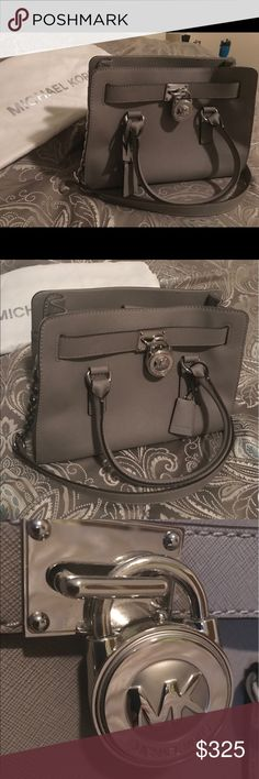 Micheal kors Hamilton bag Basically new grey leather with silver hardware micheal kors purse! Has shoulder and arm straps! Only used a handful of times! To small to carry everything I need for myself and my son on a regular basis. Hate seeing it just sit in my closet so hopefully someone will put it to good use! No visible ware or stains and the leather has been treated with protectant. Michael Kors Bags Shoulder Bags