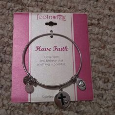 Alex and Ani type bracelet!  Brand new gorgeous Footnotes too have faith bracelet...  Has cross charm and a pink pearl and a heart and faith charm..  Very pretty and nice looking. Alex & Ani Jewelry Bracelets